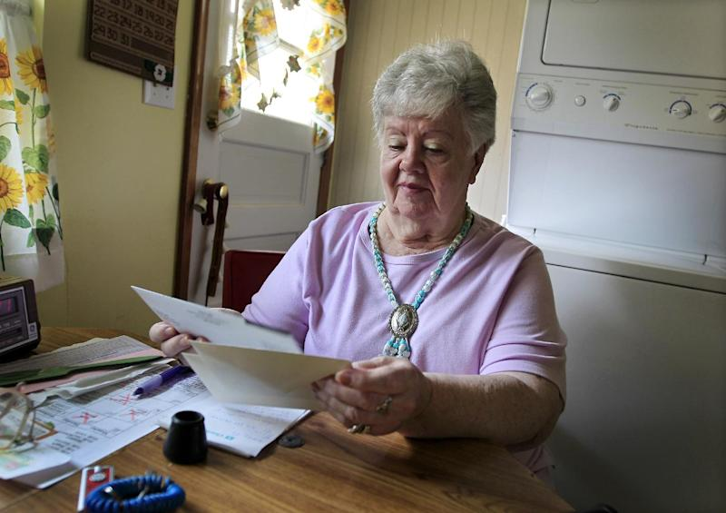 "In this July 26, 2012, photo, Neta Homier looks over bills in her home in Toledo, Ohio. Homier says she relies on Social Security to pay her bills and while she is confident the program will continue to help her she fears it will not be able to rely on it. ""Social Security is what's carrying me,"" Homier said. ""It pays all my bills."" People retiring today are part of the first generation of workers who have paid more in Social Security taxes during their careers than they will receive in benefits after they retire. It's a historic shift that will only get worse for future retirees, according to an analysis by The Associated Press. Previous generations got a much better bargain, mainly because payroll taxes were very low when Social Security was enacted in the 1930s and remained so for decades. (AP Photo/Carlos Osorio)"