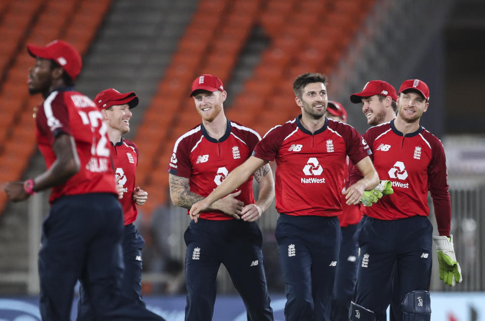 Mark Wood, third right, celebrates the wicket of Rohit Sharma in Ahmedabad. (AP Photo/Aijaz Rahi)