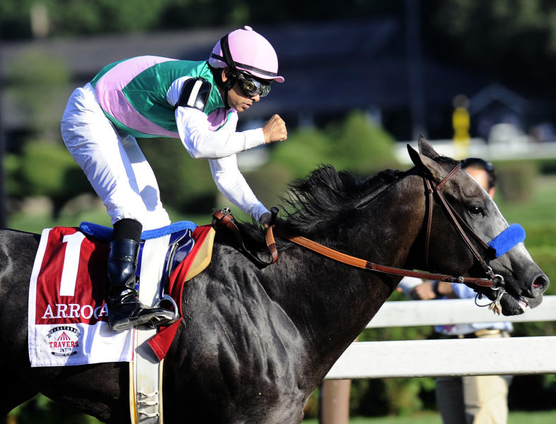 FILE - In this Aug. 27, 2016, file photo, jockey Mike Smith celebrates aboard Arrogate after winning the Travers Stakes horse race at Saratoga Race Course in Saratoga Springs, N.Y. Arrogate, winner of the 2016 Breeders Cup Classic and the champion 3-year-old male that year on his way to becoming North Americas all-time leading money earner, has died. He was seven. Juddmonte Farms said Arrogate was euthanized Tuesday, June 2, 2020, after becoming ill.(AP Photo/Hans Pennink, File)