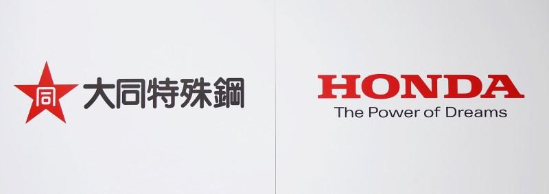 The Company Logos Of Honda Motor Co And Daido Steel Are Displayed During