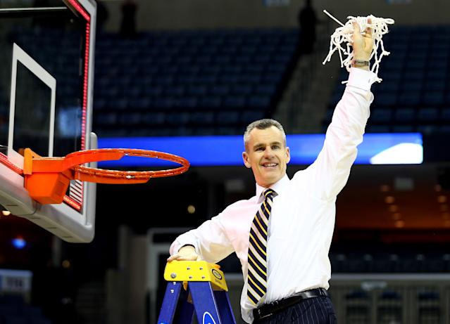 Florida will name its basketball court after former coach Billy Donovan, seen here cutting down the net after winning a regional in the 2014 NCAA tournament. (Streeter Lecka/Getty Images)