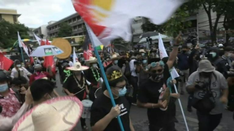Anti-government protesters march, calling for the premier to resign