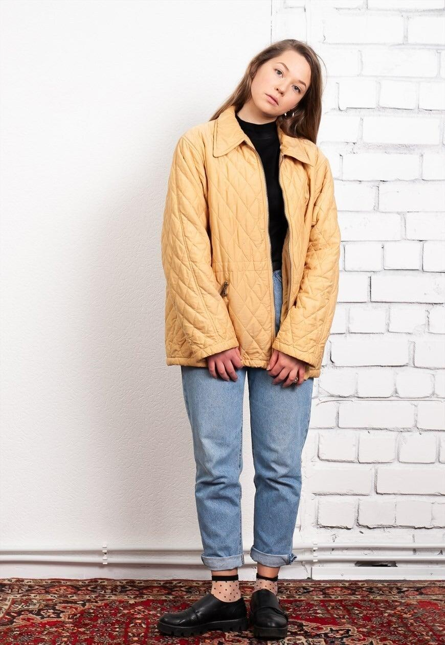 """<br><br><strong>NorthernGirl</strong> Vintage 90s Yellow Lightweight Quilted Jacket, $, available at <a href=""""https://marketplace.asos.com/listing/jackets/vintage-90s-yellow-lightweight-quilted-jacket/5849726?"""" rel=""""nofollow noopener"""" target=""""_blank"""" data-ylk=""""slk:asos marketplace"""" class=""""link rapid-noclick-resp"""">asos marketplace</a>"""