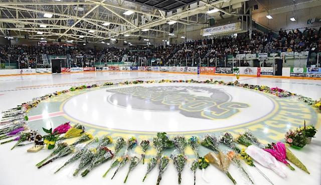 Flowers lie at centre ice on April 8, 2018. as people gather for a vigil at the Elgar Petersen Arena, home of the Humboldt Broncos (AFP Photo/JONATHAN HAYWARD)