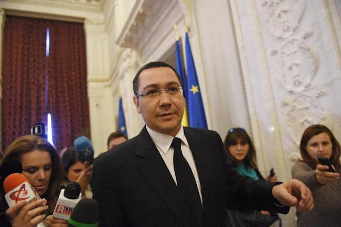 Romanian Prime Minister Victor Ponta said top officials took responsibility for the deadly nightclub blaze in Bucharest (AFP Photo/Daniel Mihailescu)