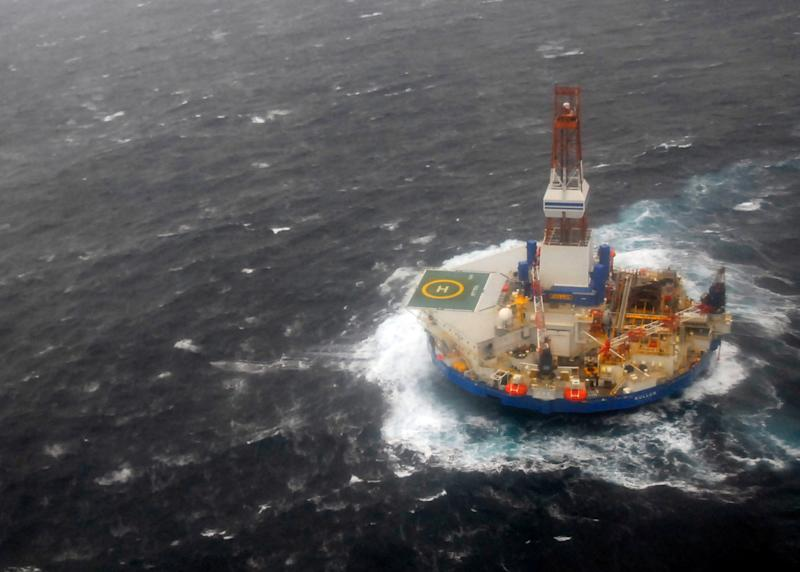 In this photo provided by the U.S. Coast Guard, the mobile drilling unit Kulluk is towed by the tugs Aiviq and Nanuq in 29 mph winds and 20-foot seas 116 miles southwest of Kodiak City, Alaska, Sunday, Dec. 30, 2012. The crews remain stationed with the drill rig Kulluk Sunday 20 miles from Alaska's Kodiak Island as they wait in rough seas for another tug boat to arrive. The Coast Guard says the goal is to tow the Kulluk to a safe harbor and determine the next step. (AP Photo/U.S Coast Guard, Chris Usher)