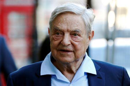 Business magnate George Soros arrives to speak at the Open Russia Club in London