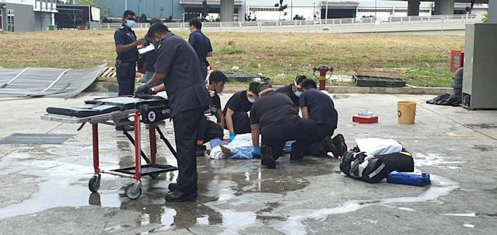 SCDF's Emergency Medical Services (EMS) crew attending to one of the injured persons. (PHOTO: Singapore Civil Defence Force Facebook page)