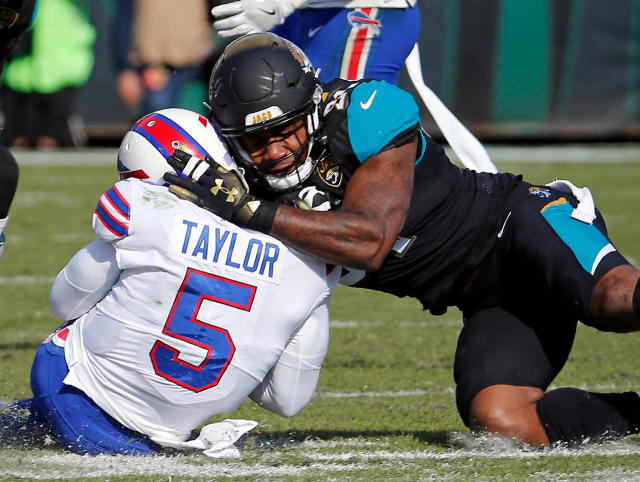 FILE - In this Jan. 7, 2018, file photo, Jacksonville Jaguars defensive end Yannick Ngakoue, right, draws a penalty by hitting Buffalo Bills quarterback Tyrod Taylor (5) with helmet-to-helmet contact in the first half of an NFL wild-card playoff football game, in Jacksonville, Fla. Bob Costas isnt backing down on his belief that the NFL faces a day of reckoning on the issue of brain injuries, and talks about the one event he wishes he had been able to broadcast on the AP Sports Weekly podcast. The NBC and MLB announcer joins co-hosts Jim Litke and Tim Dahlberg to talk about a variety of issues, including the Olympics and how the growing use of analytics has made baseball into a different game than he watched growing up.(AP Photo/Stephen B. Morton, File)