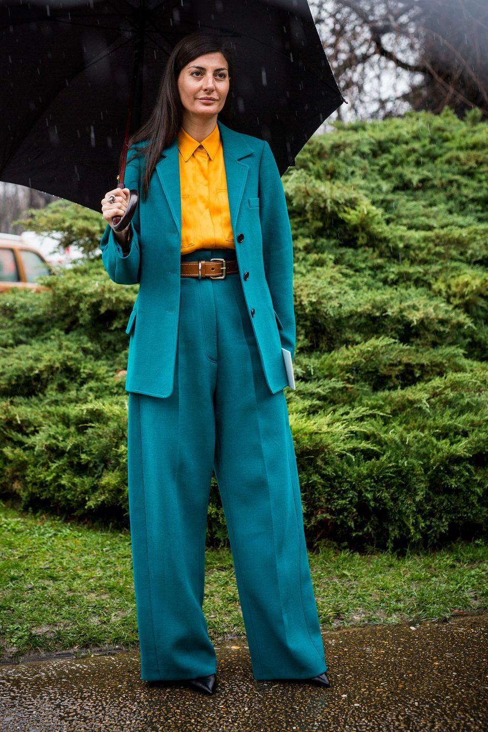 <p>For Battaglia, there's never too much colour. Even a teal wide-leg suit can be brightened with a cheerful yellow shirt, as seen in March 2017.</p>