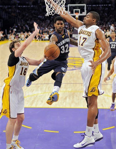 Memphis Grizzlies guard O.J. Mayo (32) goes up for a shot between Los Angeles Lakers forward Pau Gasol (16), of Spain, and center Andrew Bynum (17) defend during the first half of their NBA basketball game, Sunday, Jan. 8, 2012, in Los Angeles. (AP Photo/Mark J. Terrill)