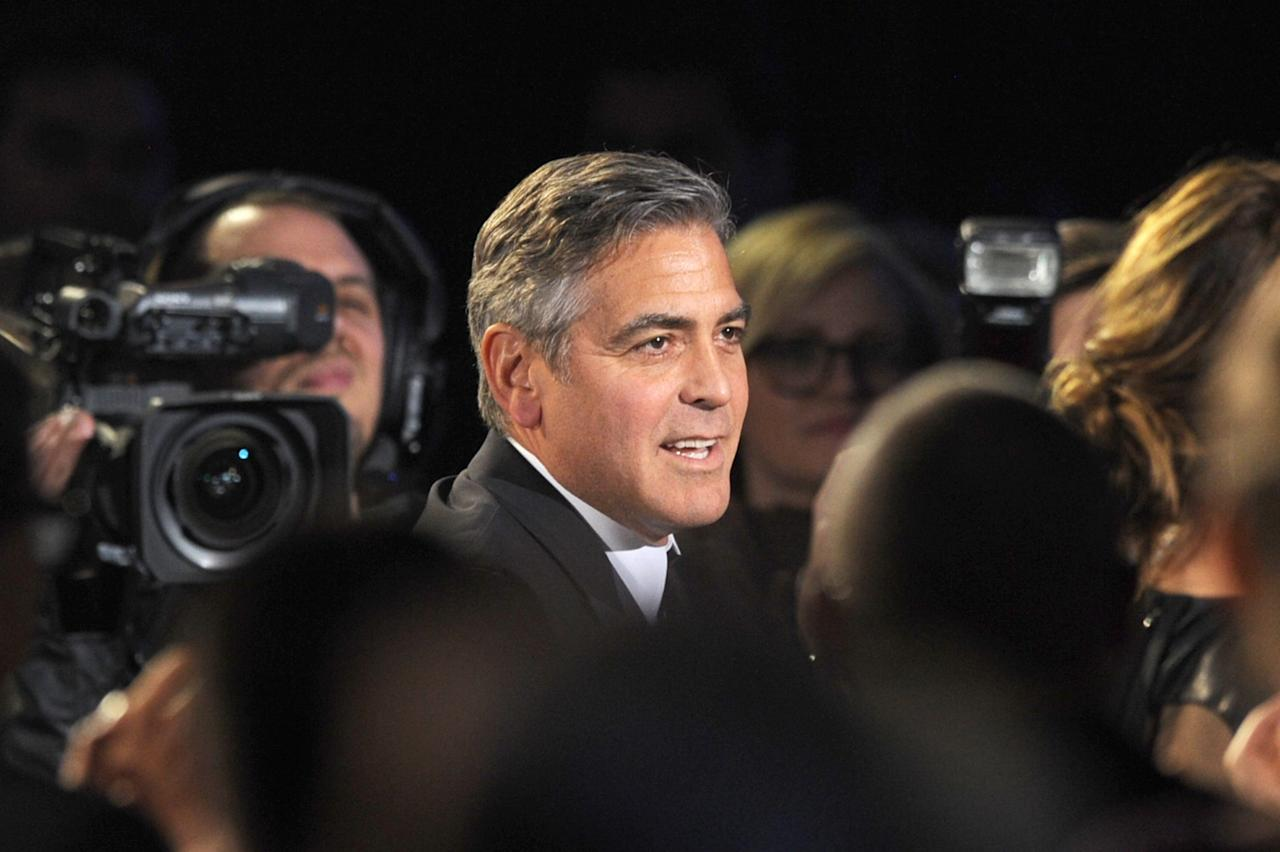 "SANTA MONICA, CA - JANUARY 10:  Producer George Clooney reacts in the audience to hearing the Best Picture Award went to ""Argo"" at the 18th Annual Critics' Choice Movie Awards held at Barker Hangar on January 10, 2013 in Santa Monica, California.  (Photo by Kevin Winter/Getty Images)"