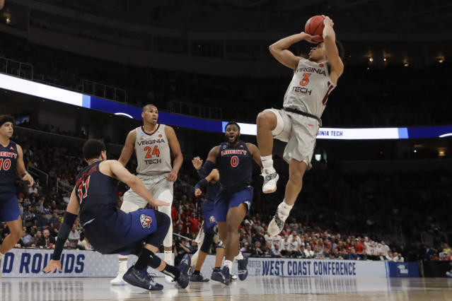 Virginia Tech guard Wabissa Bede, right, shoots over Liberty guard Georgie Pacheco-Ortiz during the second half of a second-round game in the NCAA men's college basketball tournament Sunday, March 24, 2019, in San Jose, Calif. (AP Photo/Jeff Chiu)