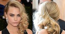 <p>As if you needed any more proof that side-swept waves are her thing, there's this springy style Delevingne wore at the 2014 Met Gala. Flipped to one side and curled in big ringlets, we love the addition of the silver chain that seems to act as both a decoration and a way to keep her hair secured in place. </p>