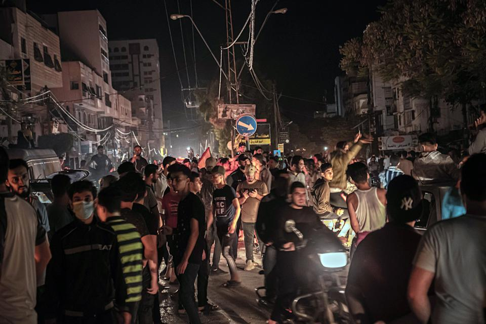<p>Palestinians in Gaza City celebrate the ceasefire agreement between Israel and Hamas on Friday</p> (Getty)