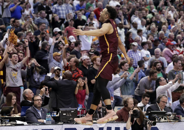 Loyola-Chicago guard Marques Townes (5) leaps while celebrating the team's 63-62 win over Tennessee in a second-round game at the NCAA men's college basketball tournament in Dallas, Saturday, March 17, 2018. (AP Photo/Tony Gutierrez)