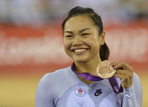 Hong Kong's Lee Wai-Sze poses on the podium after winning the bronze medal in the London 2012 Olympic Games women's Keirin final track cycling event at the Veldorome in the Olympic Park in East London, on August 3