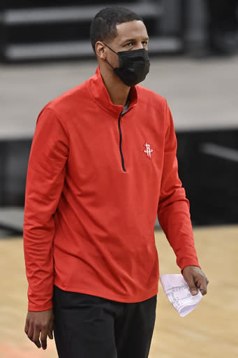 Houston Rockets head coach Stephen Silas watches play during the second half of an NBA basketball game against the San Antonio Spurs, Saturday, Jan. 16, 2021, in San Antonio. (AP Photo/Darren Abate)