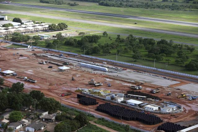 Aerial view of the light-rail vehicle (LRV, known in Brazil as VLT) train project which is expected to improve the flow of traffic from the city centre to the airport, for the 2014 World Cup in Cuiaba, November 18, 2013. The Arena Pantanal will host several 2014 World Cup soccer matches. REUTERS/Paulo Whitaker (BRAZIL - Tags: SPORT SOCIETY SOCCER WORLD CUP BUSINESS CONSTRUCTION TRANSPORT)