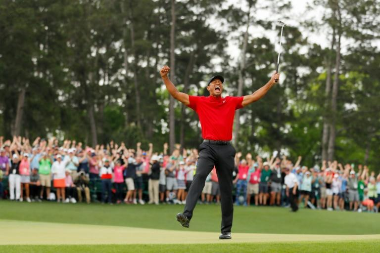 Tiger Woods, here celebrating his 15th major championship at the 2019 Masters, said he was touched to see golfers wear red and black to offer support as he recovers from serious leg injuries sustained in a car crash