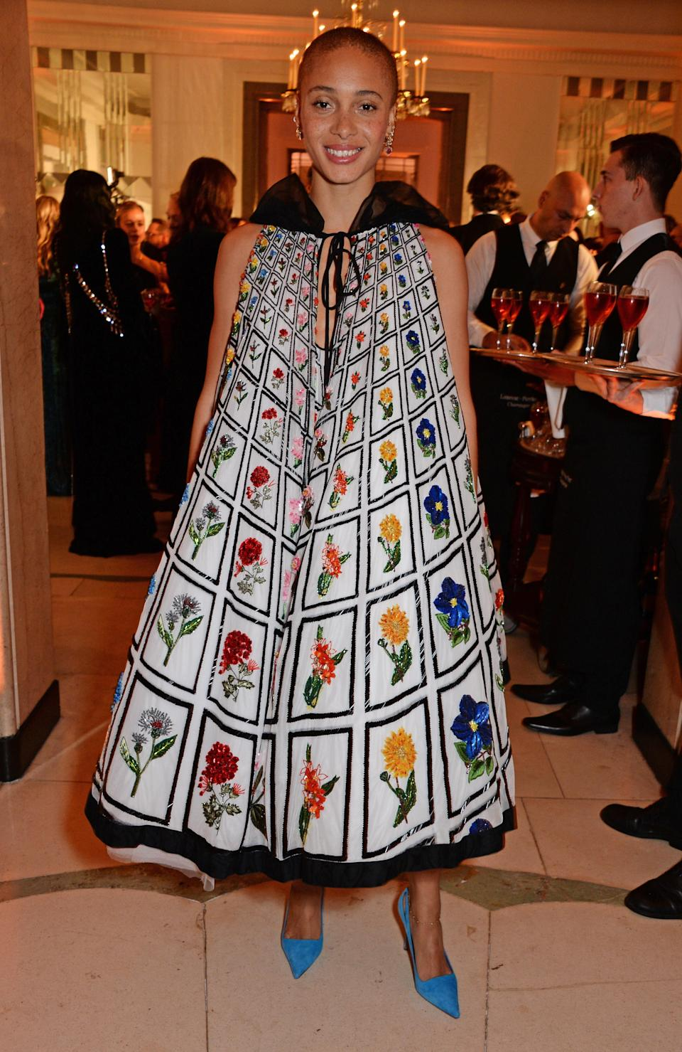 <p>The fashion model wore a one-of-a-kind <span>Mary Katrantzou gown paired with bright blue heels for the Claridge's event. </span><em>[Photo: Getty]</em> </p>