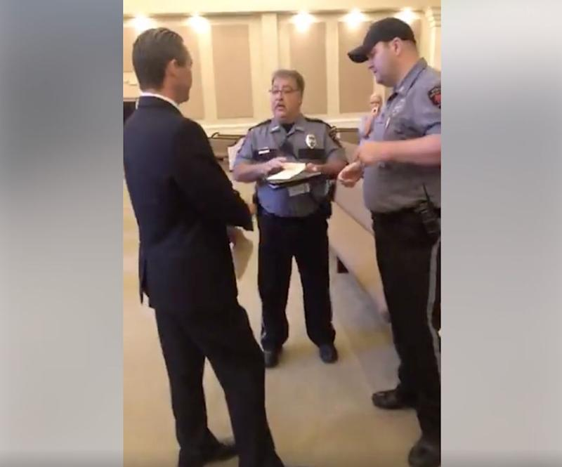Two Central Police Department officers issue a misdemeanor summons to Life Tabernacle Church pastor Tony Spell. (Photo: Facebook Live / Timothy C. Spell)