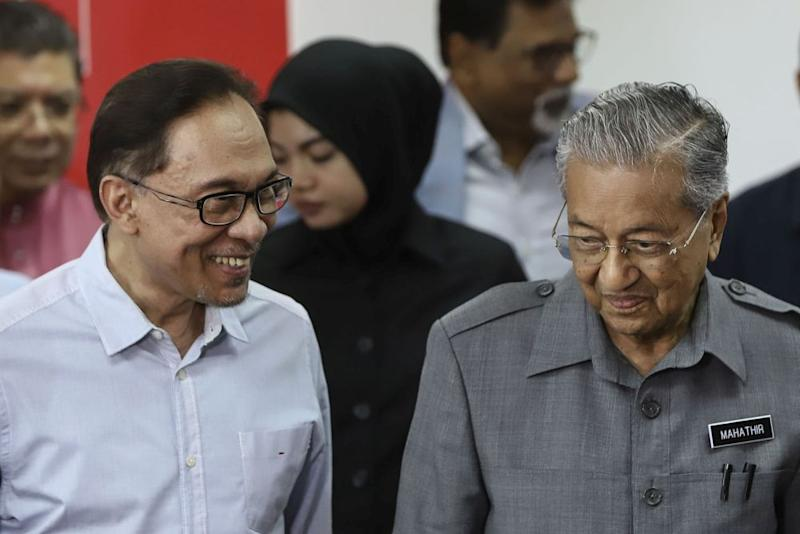 Both Dr Mahathir and Anwar have repeatedly stated that the former will relinquish the PM's post to the latter, according to PH's succession plan. — Picture by Azneal Ishak