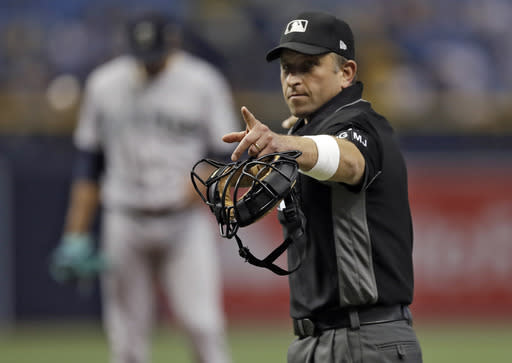 Umpires will be wearing white wristbands during all games to protest the escalating verbal attacks by the players. (AP)