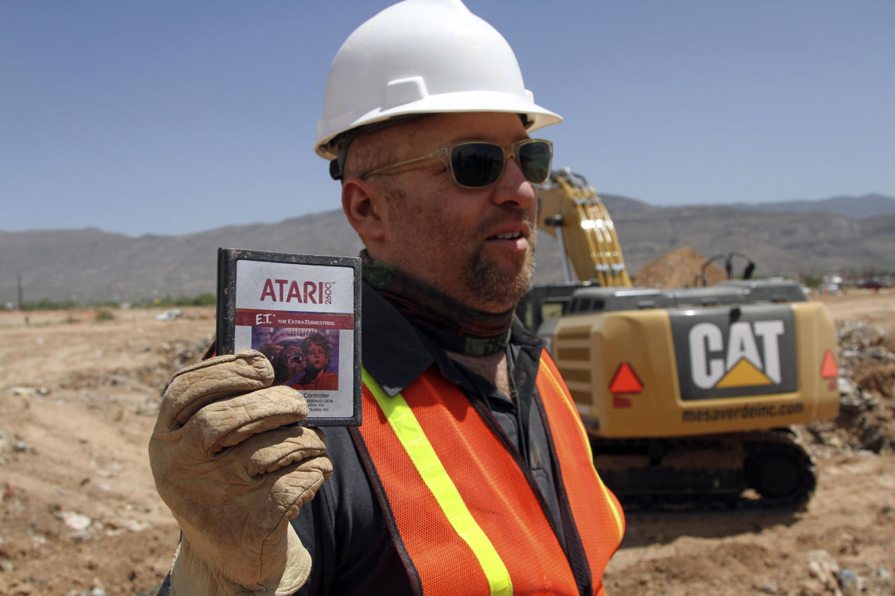 Film Director Zak Penn shows a box of a decades-old Atari 'E.T. the Extra-Terrestrial' game found in a dumpsite in Alamogordo, N.M., Saturday, April 26, 2014. Producers of a documentary dug in a southeastern New Mexico landfill in search of millions of cartridges of the game that has been called the worst game in the history of video gaming and were buried there in 1983. (AP Photo/Juan Carlos Llorca)