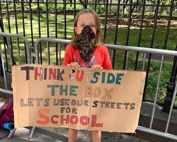 PHOTO: Fourth grader Conor Landauer holds a sign outside City Hall at a rally to demand street closures and park permits for New York City schools, Aug. 20, 2020. (Courtesy Amanda Ritchie)