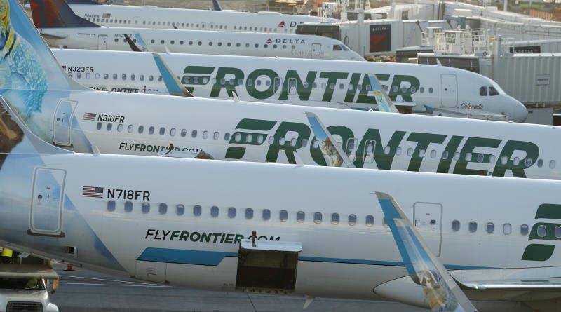 In this late Wednesday, June 26, 2019, photograph, Frontier Airlines jetliners sit at gates on the A concourse at Denver International Airport in Denver. (AP Photo/David Zalubowski)