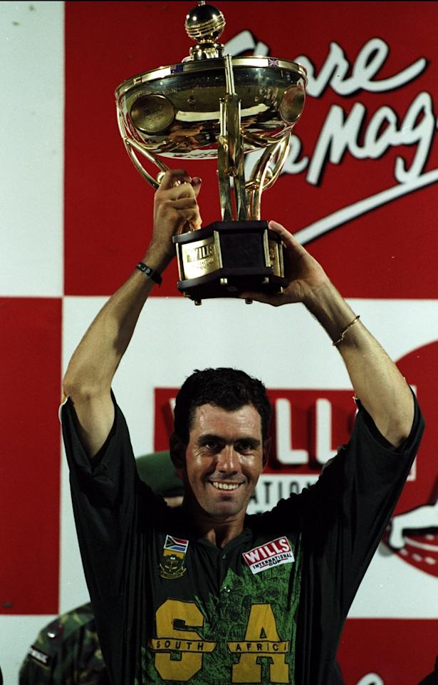 1 Nov 1998:  The South African captain Hansie Cronje lifts the trophy in celebration of winning the Wills International Cup at the Bangabandhu National Stadium in Dhaka in Bangladesh. \ Mandatory Credit: Stu Forster /Allsport