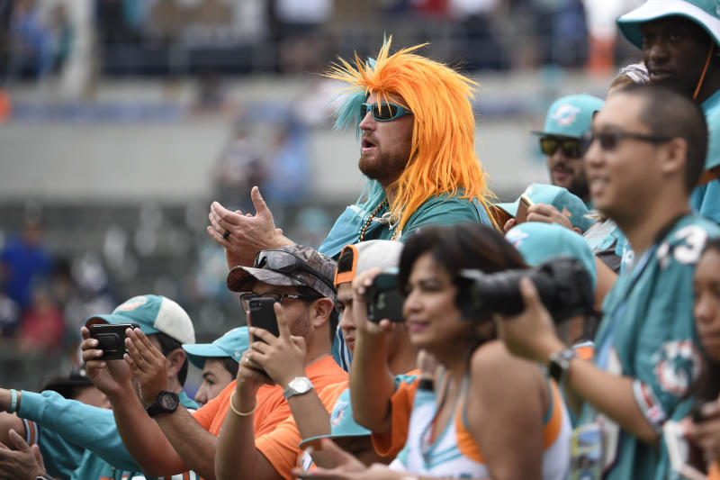 Fans for the Miami Dolphins look on before the Dolphins played the Chargers in the Chargers' first game in Los Angeles after their move. (AP)