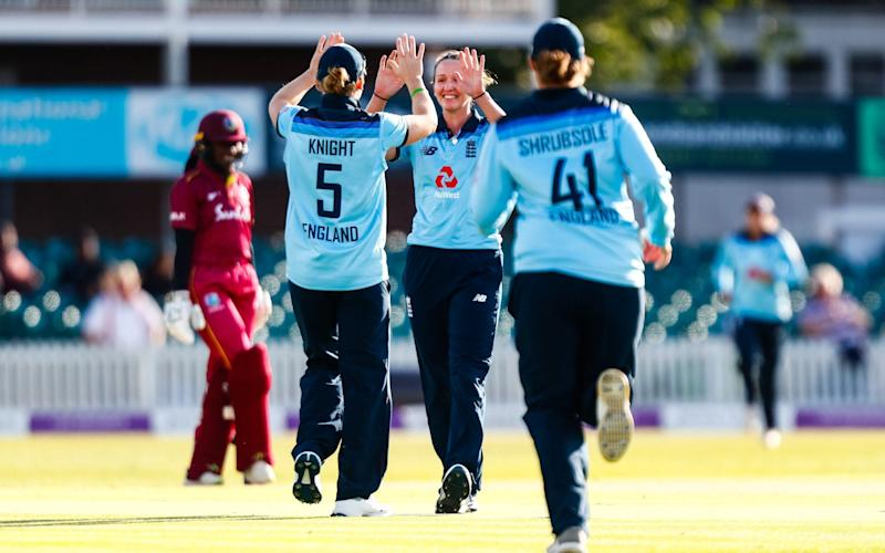 Kate Cross, centre, has adapted into a skilful white-ball bowler - Action Plus