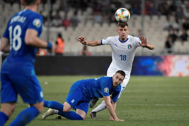 Italy's Nicolo Barella vies for the ball with Greece's Konstantinos Fortounis. (Credit: AFP)