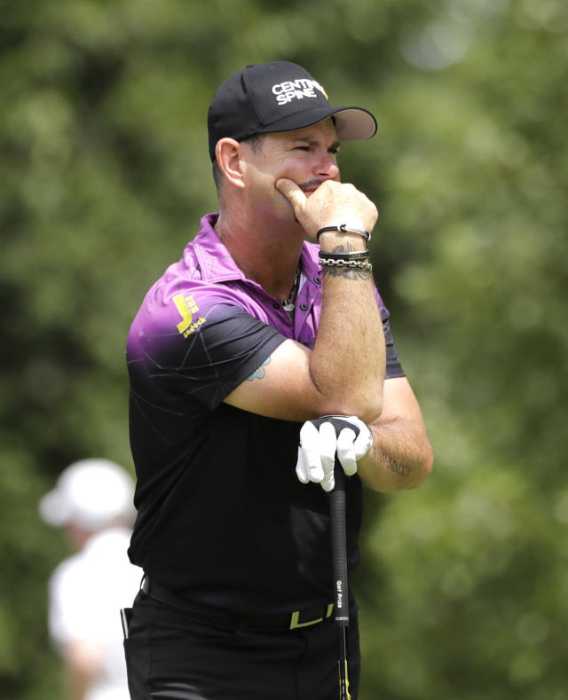 Rory Sabbatini reacts after hitting his tee shot on the fifth hole during the final round of the BMW Championship golf tournament at Medinah Country Club, Sunday, Aug. 18, 2019, in Medinah, Ill. (AP Photo/Nam Y. Huh)