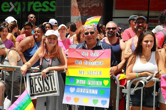 <p>A man holds a sign supporting family members during the N.Y.C. Pride Parade in New York on June 25, 2017. (Photo: Gordon Donovan/Yahoo News) </p>