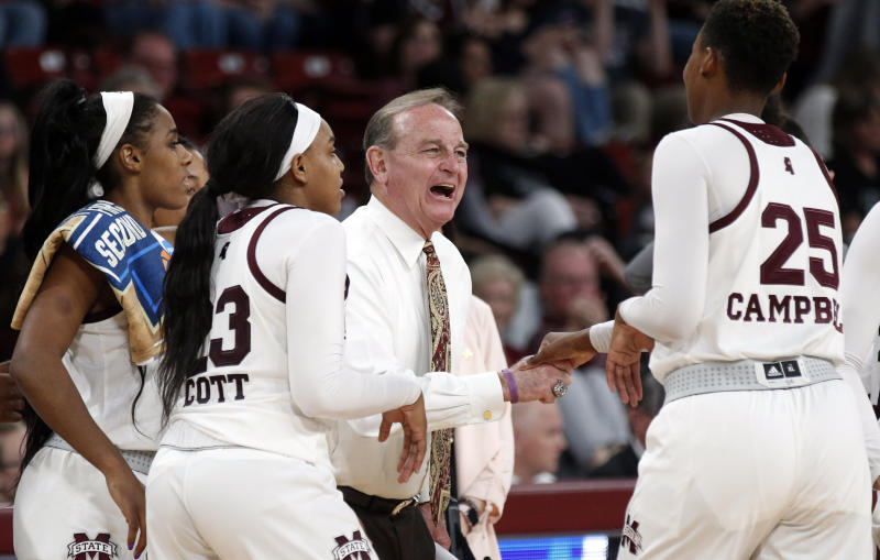 Mississippi State coach Vic Schaefer smiles as he greets center Zion Campbell (25) as she comes off the court during the second half against Southernd in a first-round game in the NCAA womens college basketball tournament in Starkville, Miss., Friday, March 22, 2019. Mississippi State won 103-46. (AP Photo/Rogelio V. Solis)
