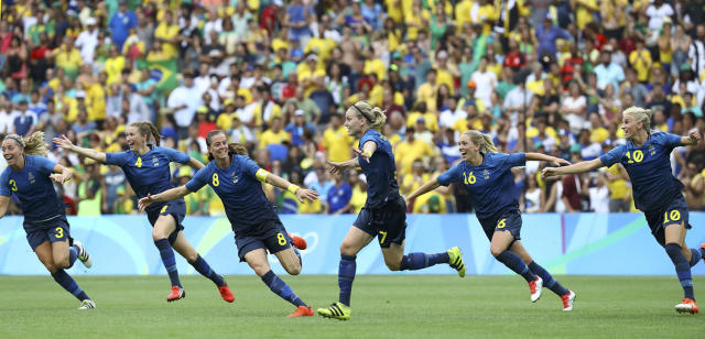 <p>Dahlkvist of Sweden (C) celebrates with teammates after scoring the winning goal during the penalty shoot out at the women's soccer semifinal between Brazil and Sweden on August 16, 2016. (REUTERS/Leonhard Foeger) </p>