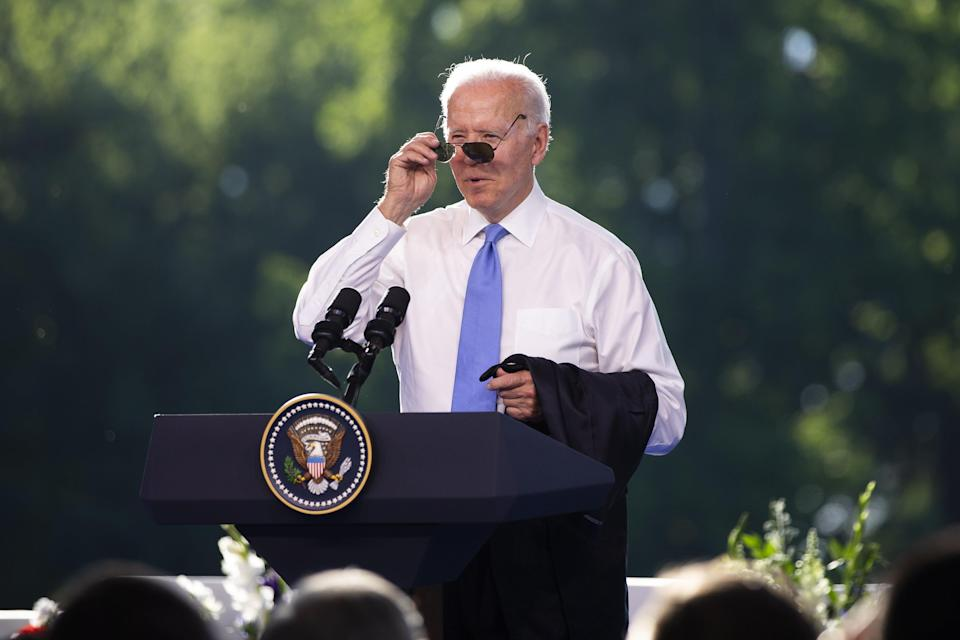 President Biden puts on his sunglasses at the end of the press conference (EPA)