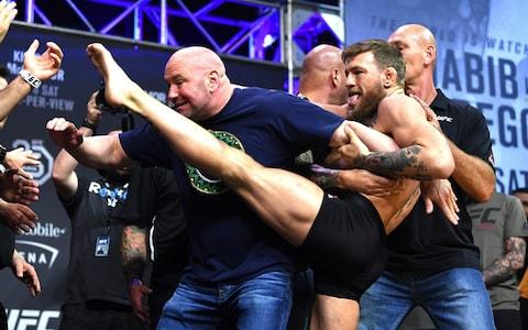 McGregor aims a kick at Nurmagomedov during their weigh-in - Credit: Jeff Bottari/Zuffa LLC