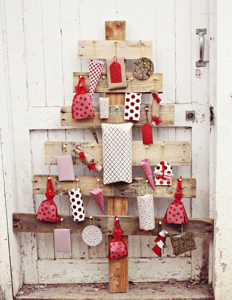 """<p>This pallet advent tree is a beauty in and of itself, but to make it <em>really</em> pop, be sure to wrap the packages pinned to it in colorful red-and-white paper.</p><p><strong>Get the tutorial at <a href=""""https://abeautifulmess.com/diy-advent-tree/"""" rel=""""nofollow noopener"""" target=""""_blank"""" data-ylk=""""slk:A Beautiful Mess"""" class=""""link rapid-noclick-resp"""">A Beautiful Mess</a>.</strong></p><p><a class=""""link rapid-noclick-resp"""" href=""""https://www.amazon.com/AmazonBasics-Hickory-Wood-Handle-Hammer/dp/B07TGH9TFK/ref=asc_df_B07TGH9TFK/?tag=syn-yahoo-20&ascsubtag=%5Bartid%7C10050.g.23322271%5Bsrc%7Cyahoo-us"""" rel=""""nofollow noopener"""" target=""""_blank"""" data-ylk=""""slk:SHOP HAMMERS"""">SHOP HAMMERS</a><br></p>"""