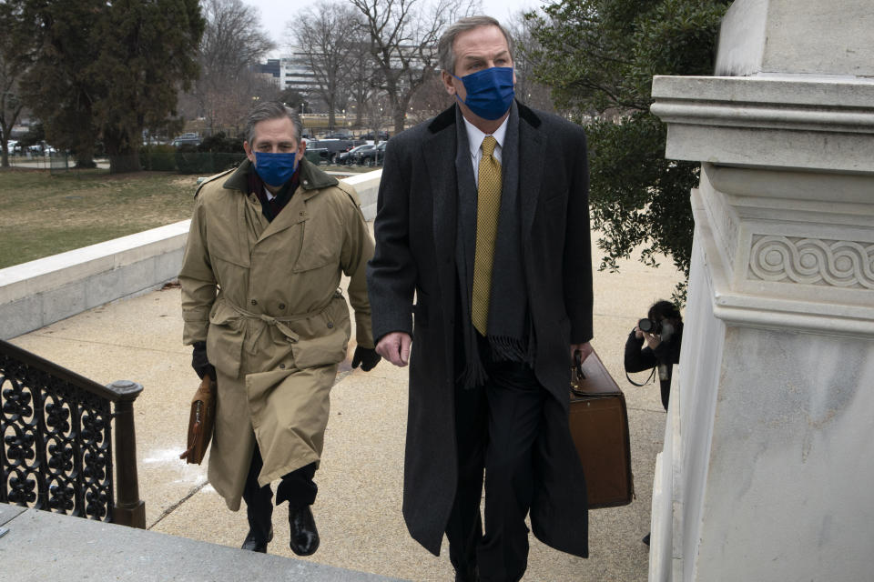 Bruce Castor, left, and Michael van der Veen, lawyers for former President Donald Trump, arrive at the Capitol on the fourth day of the second impeachment trial of Trump in the Senate, Friday, Feb. 12, 2021, in Washington. (AP Photo/Jose Luis Magana)