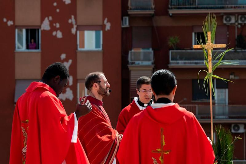 Parish priest Don Antonio Lauri celebrates Palm Sunday mass from the rooftop of the St Gabriel of Sorrows church in Rome.