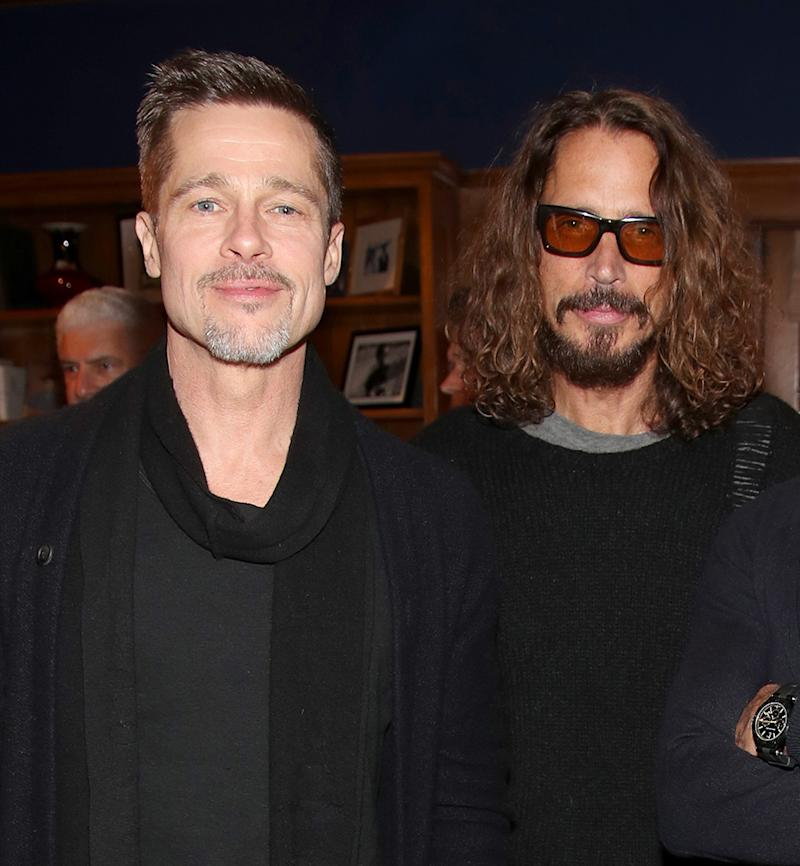 Brad Pitt, pictured with Chris Cornell at the EBMRF Benefit on January 14, has been doting on the late singer's children as they deal with the family tragedy. (Photo: Randy Shropshire/Getty Images for EBMRF)