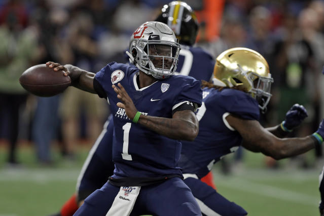 West quarterback Tyler Huntley, of Utah, throws a pass against the East during the first half of the East West Shrine football game Saturday, Jan. 18, 2020, in St. Petersburg, Fla. (AP Photo/Chris O'Meara)