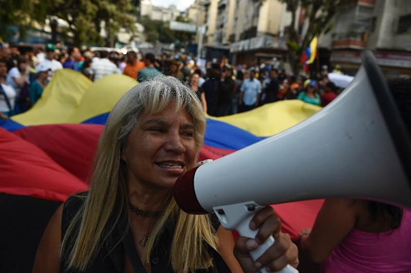 A Maduro opponent takes part in a demonstration in Caracas on March 12, 2019 (AFP Photo/Federico Parra                      )