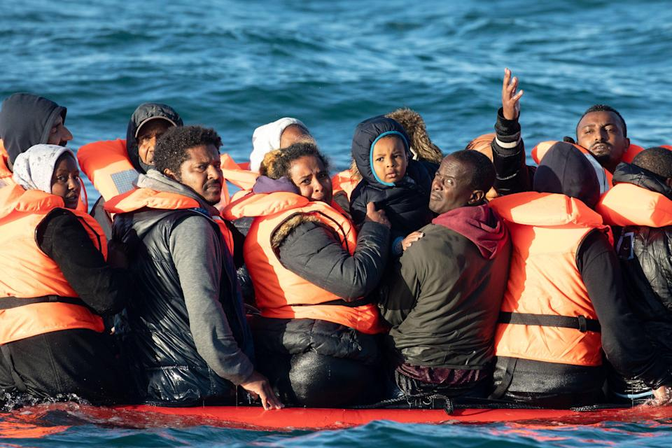 People crossing the English channel on an inflatable boat near Dover (Getty Images)