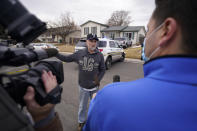 Kirby Klements talks about a piece of debris that crushed his pickup truck parked next to his home in Broomfield, Colo., as the plane shed parts while making an emergency landing at nearby Denver International Airport Saturday, Feb. 20, 2021. (AP Photo/David Zalubowski)