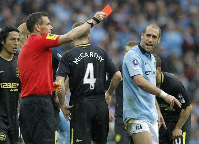 Referee Andre Marriner (L) shows Manchester City's defender Pablo Zabaleta (R) the red card to send him off after a challenge on Wigan Athletic's English striker Callum McManaman earned Zabaleta a second yellow card during the English FA Cup final at Wembley Stadium in London on May 11, 2013
